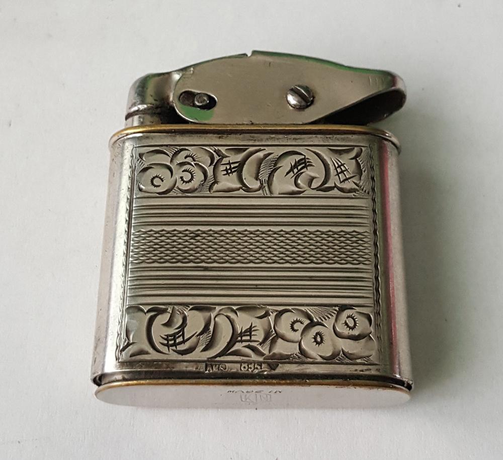 Stříbrný zapalovač KIN